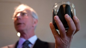 David Black holds a jar of raw bitumen in Vancouver, B.C - http://www.ctvnews.ca/business/enbridge-cleanup-plans-not-specific-for-diluted-bitumen-scientist-1.930332